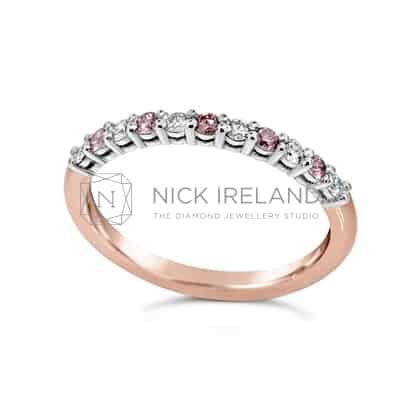 DJSP/43 18CT ROSE AND WHITE GOLD ARGYLE PINK ETERNITY RING.